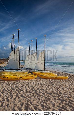 Playa Paraiso, Mexico - February 4, 2018: Colorful Sail Catamarans On The Beach At Caribbean Sea Of