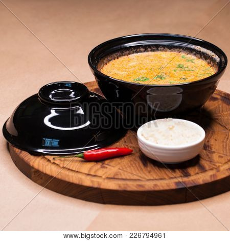Tom Yam Kung, thai food on a wooden tray