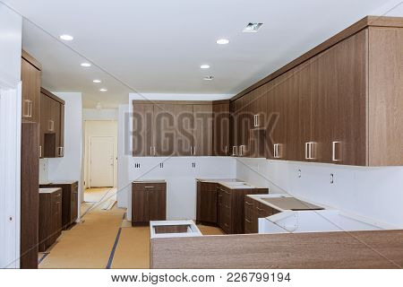 Custom Kitchen Cabinets In Various Stages Of Installation Base For Island In Center Installation Of