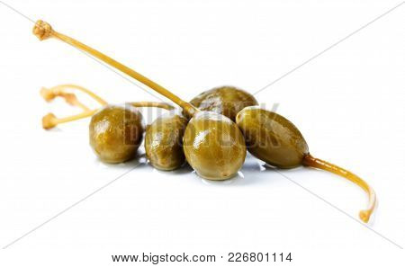 Pickled Caper Berries Isolated On White Background .
