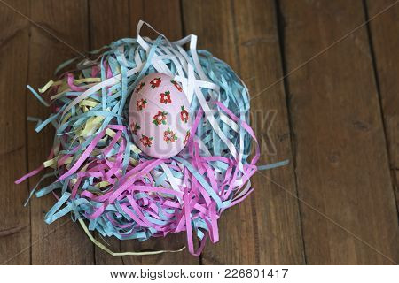 Painted Eggs Lie In A Basket, Wooden Background, Easter