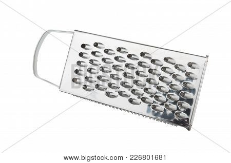 Grater For Vegetables. Kitchen Accessories. Tools For Cooking. A Spoon. Isolated On White Background