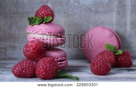Three Raspberry Macaroons And Seven Fresh Raspberries