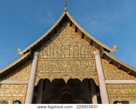 Traditional Asian Architectural Detail Ornate Facade Of Thai Buddhist Temple With Curving Roof Line