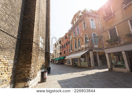 One Of The Many Streets Of Venice With Many Cafes, Shops, Tourists, Italy. Venice Is A Popular Touri