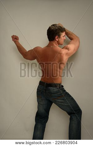 The Desirable Looking Man Stretches Out His Body.
