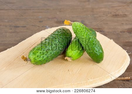 Cucumbers On A Wooden Background..