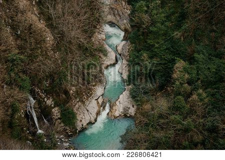 High And Powerful Waterfall Flowing Into The Clear River In Georgia. Martvili Canyon. Okatse Canyon