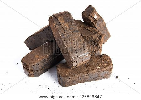 Peat Briquettes On White Background, Alternative Fuels, Raw Material