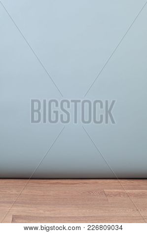 Grey Silver Color Studio Background And Wooden Parquet Floor