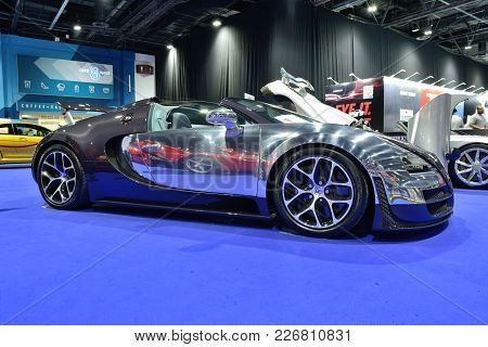 Dubai, Uae - November 18: The Bugatti Veyron 6.4 Grand Sport Vitesse Sportscar Is On Boulevard Of Dr