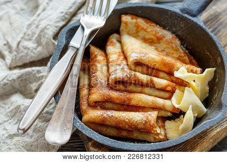 Crepes With Butter Sprinkled With Powdered Sugar.