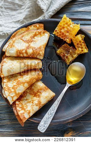 Crepes And Honey For A Delicious Breakfast.
