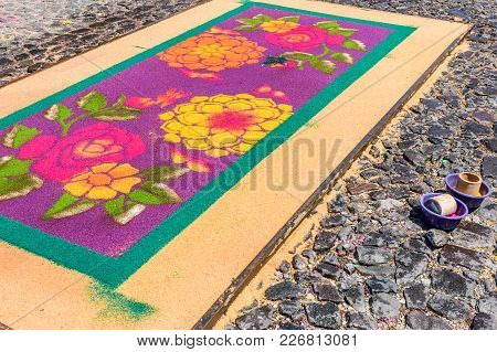 Antigua, Guatemala -  April 13, 2017: Incomplete Dyed Sawdust Holy Thursday Procession Carpet In Tow