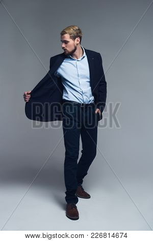 Stylish And Confident. A Full-length Portrait Of Business Person Holding The Lapel Of The Jacket And