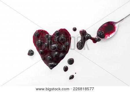 Berry Jam Splats Isolated On White, Shaped Heart And Spoon