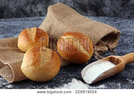 Different Kinds Of Bread And Bread Rolls On Board From Above. Kitchen Or Bakery Poster Design