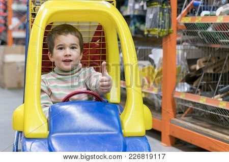 The Boy Is 4 Years Old In A Construction Shopthe Boy Is 4 Years Old In A Construction Shop, Sitting