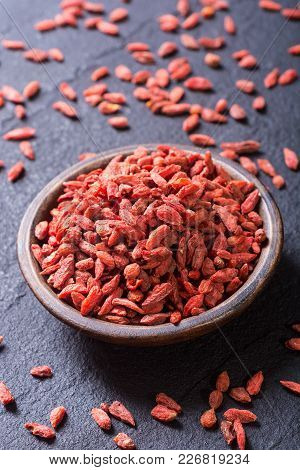Goji Red Berries In Bowl . Superfood Background