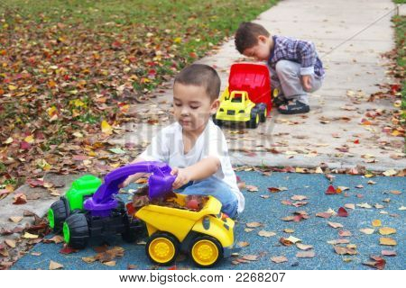 Boys Playing With Toy Trucks