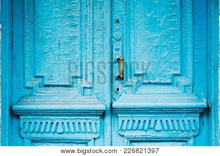 Close-up Keyholes With Curtains And A Handle On The Blue Many Times Painted Cracked Double-barreled