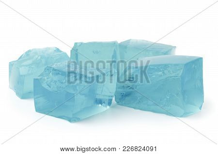 Blue Ice Cubes On A White Background, Close Up.