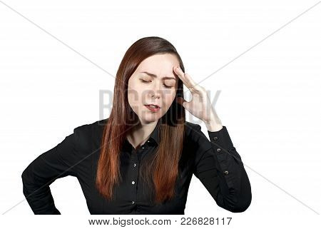Young Woman On A White Background Has Put A Hand To Her Forehead And Closed Her Eyes, Expressing Dee