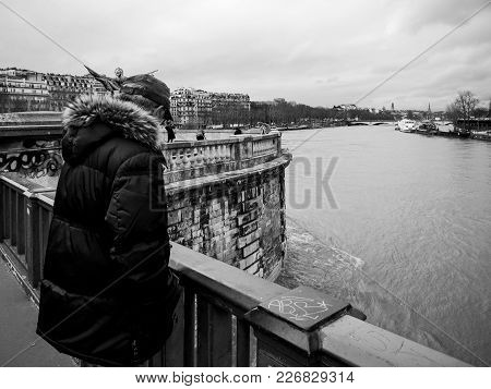 Parisian French Man Watching The Flooding Swollen Seine River
