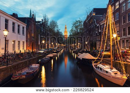 Canals Of Amsterdam At Night In Netherlands. Amsterdam Is The Capital And Most Populous City Of The