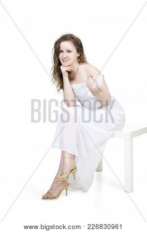 Emotions Of Beautiful Girl In A White Dress.