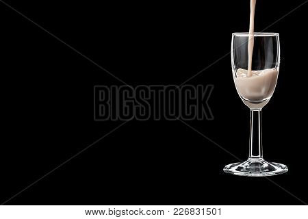 A Shot Glass Filled With Liquor Isolated On Black Background. Place For Your Text.