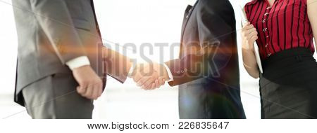 Young businessman shaking hands after agree to collaborate.