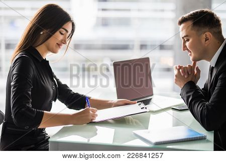 Business Partners Signing Contract At Office Desk