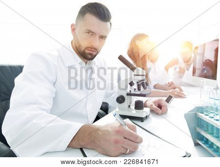 serious scientists working in the laboratory