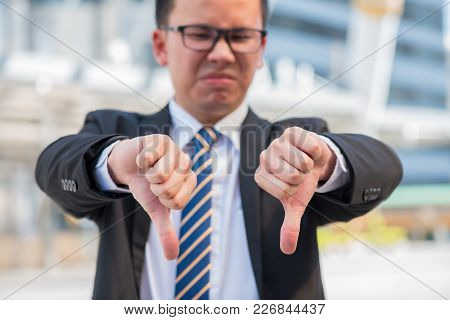 Asian Businessman With His Hand Showing Unsuccessful And Fail