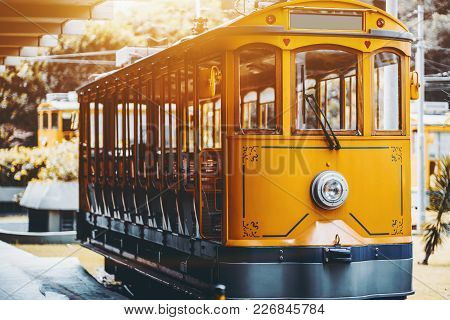 View Of Empty Yellow Glossy Excursion Tram Waiting At Tramway Station In Rio De Janeiro: Single Head