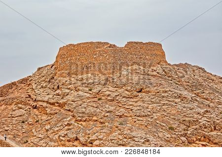 Yazd, Iran - May 4, 2015: View Of The Old Tower Of Silence Hill In Desert On The Edge Of Town.
