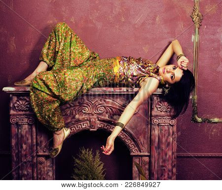 Portrait Of Beauty Sensual Young Woman In Oriental Style Luxury Room, Lifestyle People Close Up