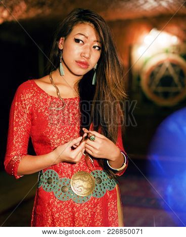 Young Pretty Asian Girl In Bright Colored Interior On Carpet. Lifestyle People Concept
