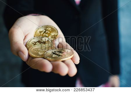 Businesswoman Holding Bitcoin, Color Of Vintage Tone