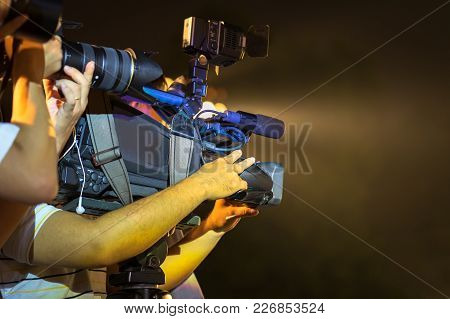 Closeup Of Professional Television Camera In Event At Night.