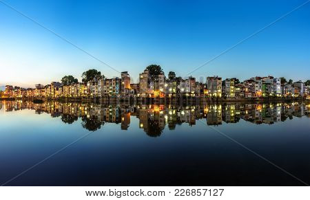 Hanoi Cityscape At Sunset. Resident Buildings By Tien Bien Lake, Gia Lam District
