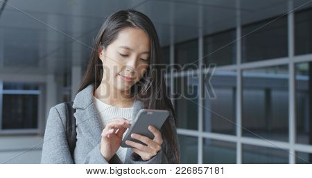 Business woman using smart phone at outdoor