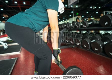 Asian Female Fitness Performing Doing Deadlift Exercise With Weight Bar