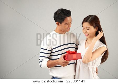 Young Asian Man Giving Gift To His Beautiful Girlfriend On Valentines Day