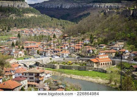 The Yantra River And Asenov District Of Veliko Tarnovo In Bulgaria Visiting By Tourist