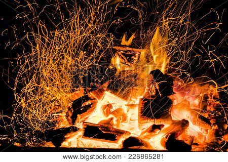 Burning Firewood In The Fireplace Close Up, Bbq Fire, Charcoal Background. Charcoal Fire With Sparks