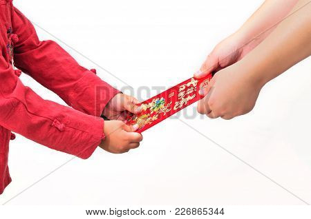 Asian child is holding red packets and Chinese calligraphy word of 'Ji xiang ru yi' meaning have one's wish fulfilled, isolated on white background, Chinese new year concept