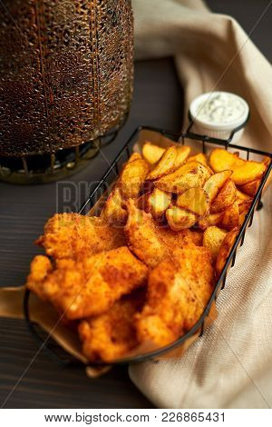Nuggets And Baked Potatoes In A Beautiful Basket With White Sauce 4