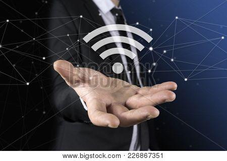 Businessman On Blurred Background Using Free Wifi Hotspot Interface